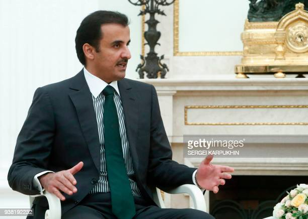 Qatar's Emir Sheikh Tamim bin Hamad alThani speaks during a meeting with Russian President at the Kremlin in Moscow on March 26 2018 / AFP PHOTO /...