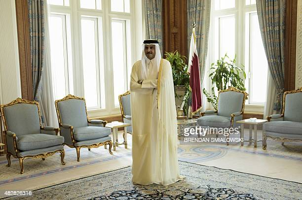 Qatar's Emir Sheikh Tamim bin Hamad alThani waits for US Secretary of State John Kerry before their meeting at the Diwan Palace on August 3 2015 in...