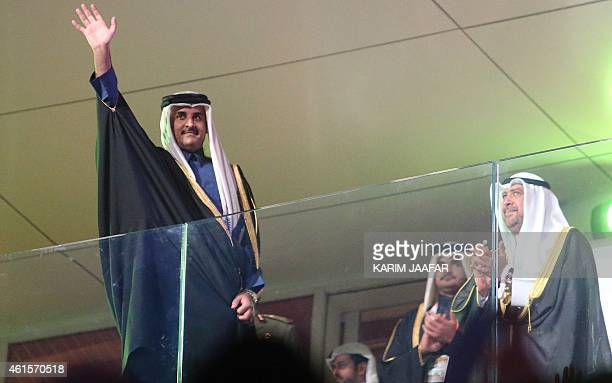 Qatar's Emir Sheikh Tamim bin Hamad AlThani waves during the 24th Men's Handball World Championships opening ceremony at the Lusail Multipurpose Hall...