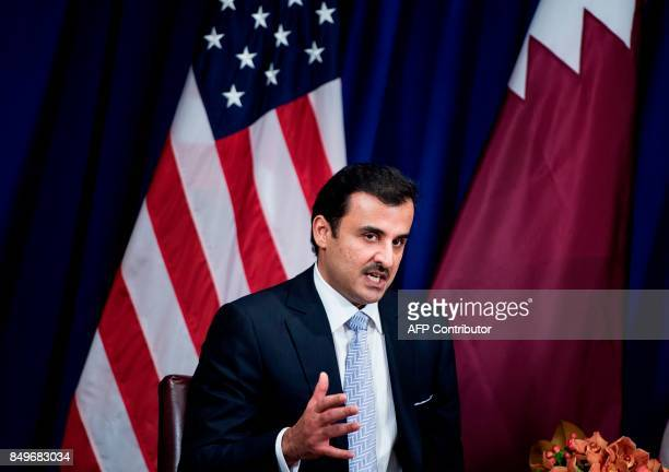 Qatar's Emir Tamim bin Hamad alThani makes a statement to the press before a meeting with US President Donald Trump at the Palace Hotel on September...