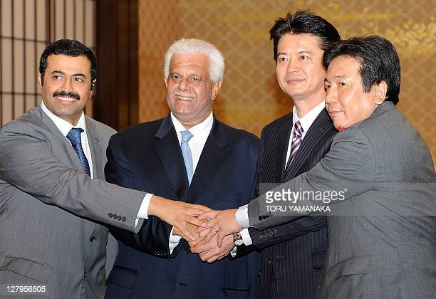 Qatar's Energy Minister Mohammed Saleh AlSada and Deputy Prime Minister Abdullah bin Hamad AlAttiyah are welcomed by Japanese Foreign Minister...