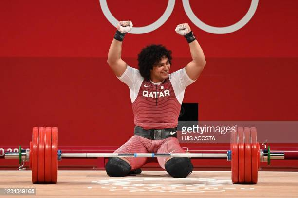 Qatar's Fares Ibrahim E H Elbakh celebrates after winning the gold medal in the men's 96kg weightlifting competition during the Tokyo 2020 Olympic...