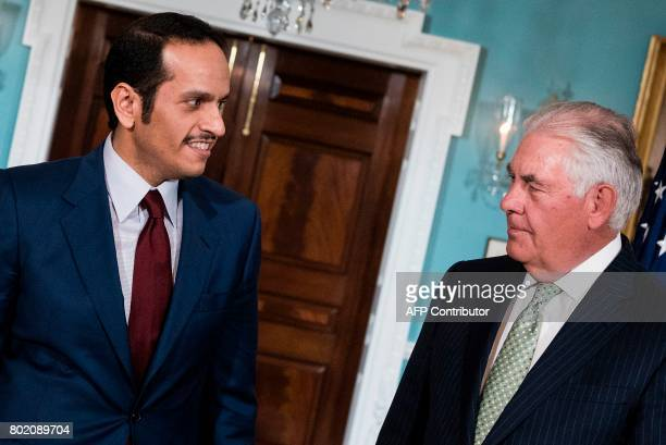 Qatar's Foreign Minister Mohammed bin Abdulrahman alThani and US Secretary of State Rex Tillerson stand together before a meeting at the US State...