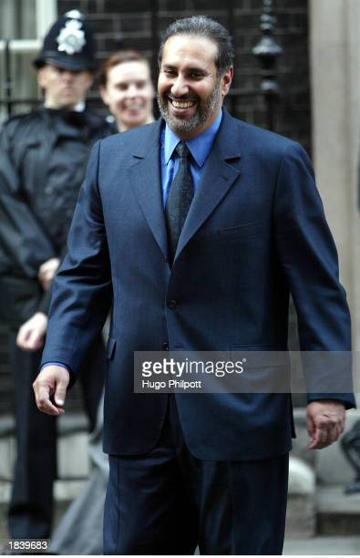 Qatars Foreign Minister Sheikh Jasem Bin Hamed Al Thani leaves No10 Downing St after meeting for talks about Iraq with British Prime Minister Tony...