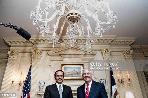 Qatar's Foreign Minister Sheikh Mohammed bin Abdulrahman and US Secretary of State Rex W Tillerson pose for a photo before a meeting at the State...