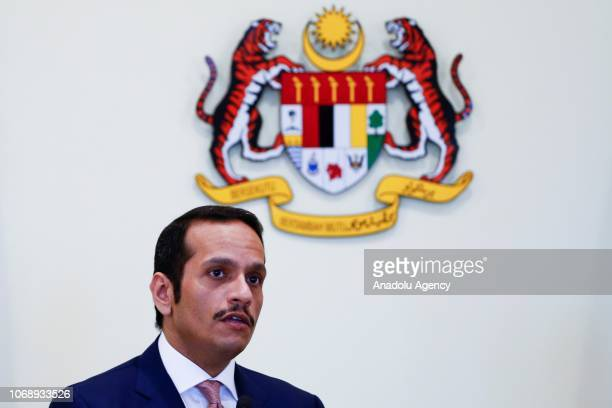 Qatar's Foreign Minister Sheikh Mohammed bin Abdulrahman bin Jassim Al Thani talks to media during a joint press conference with Malaysias Foreign...