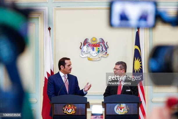 Qatar's Foreign Minister Sheikh Mohammed bin Abdulrahman bin Jassim Al Thani and Malaysias Foreign Minister Saifuddin Abdullah hold a joint press...