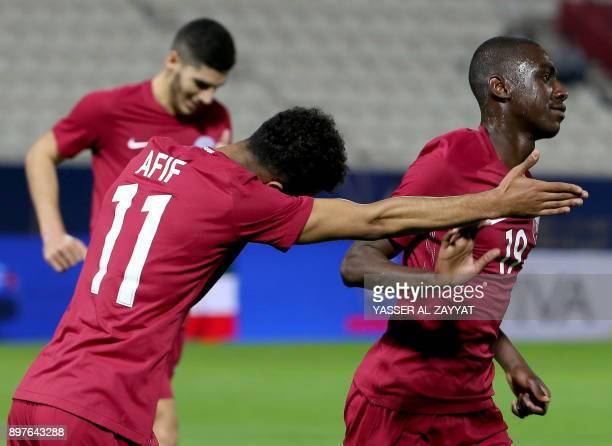Qatar's forward Akram Afif celebrates after scoring a goal against Yemen during their 2017 Gulf Cup of Nations football match between Qatar and Yemen...