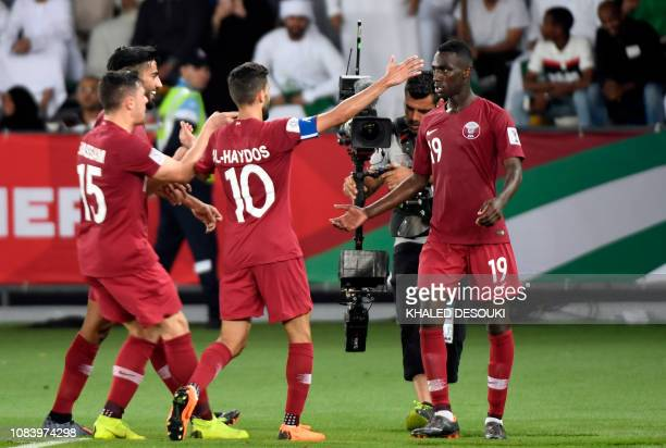 Qatar's forward Almoez Ali celebrates his goal with teammates during the 2019 AFC Asian Cup group E football match between Saudi Arabia and Qatar at...