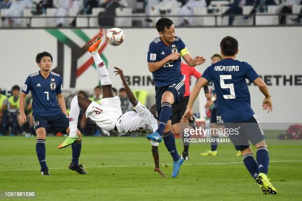 Qatar's forward Almoez Ali shoots to score during the 2019 AFC Asian Cup final football match between Japan and Qatar at the Zayed Sports City...