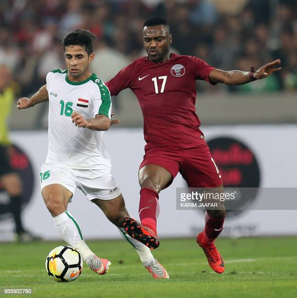 Qatar's forward Ismail Mohamed vies for the ball against Iraq's midfielder Hussein Ali AlSaedi during their international friendly match at Basra...