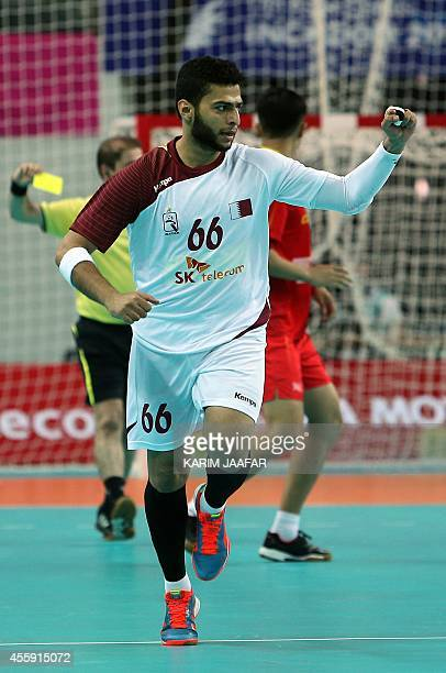 Qatar's Hamad Madadi celebrates during his team's victory over China in their men's handball preliminary round match during the 17th Asian Games at...