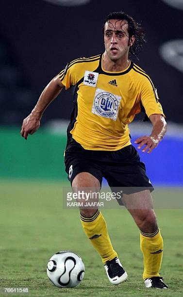 Qatar's Iranian footballer Ali Karimi controls the ball during their Qatari championship football match against alWakra in Doha 10 September 2007 AFP...