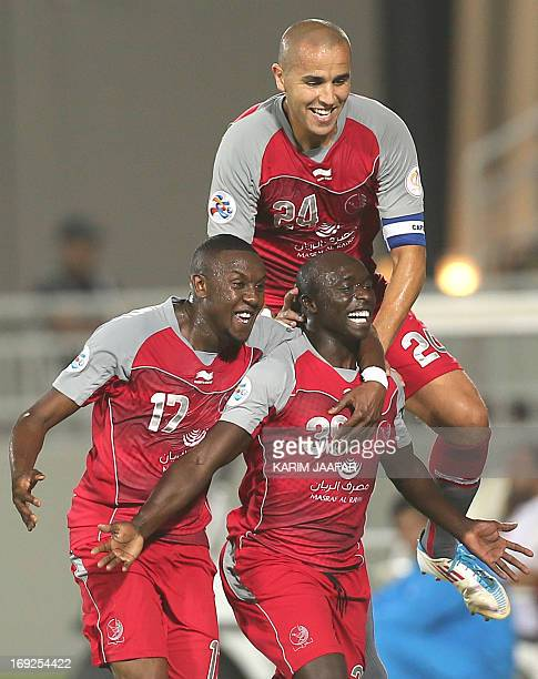 Qatar's Lekhwiya player Issiar Dia celebrates after scoring a first goal against Saudi Arabia al-Hilal club during their AFC Championship league...