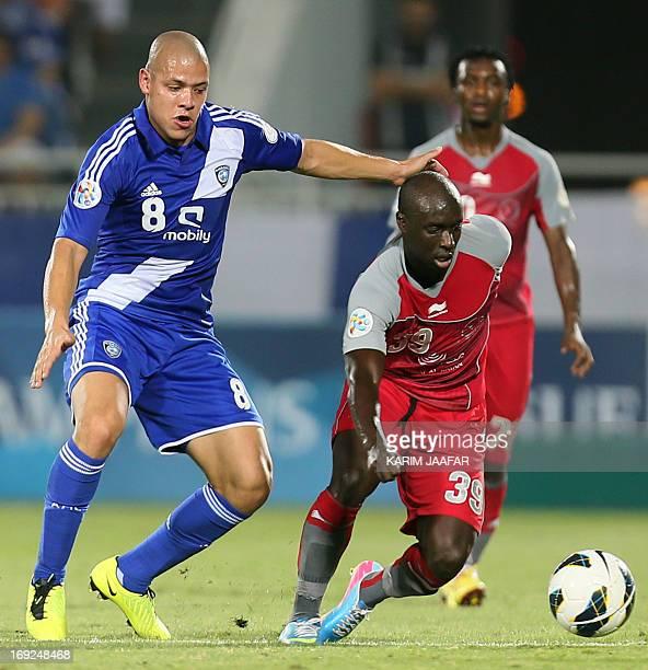 Qatar's Lekhwiya player Issiar Dia vies for the ball against a Saudi Arabia al-Hilal player Gustavo Zapata during their AFC Championship league...