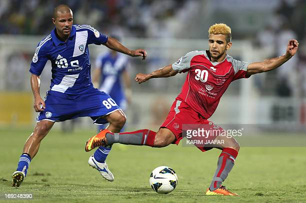 Qatar's Lekhwiya player Luiz Martin vies for the ball against a Saudi Arabia alHilal player Wesley Lopes da Silva during their AFC Championship...
