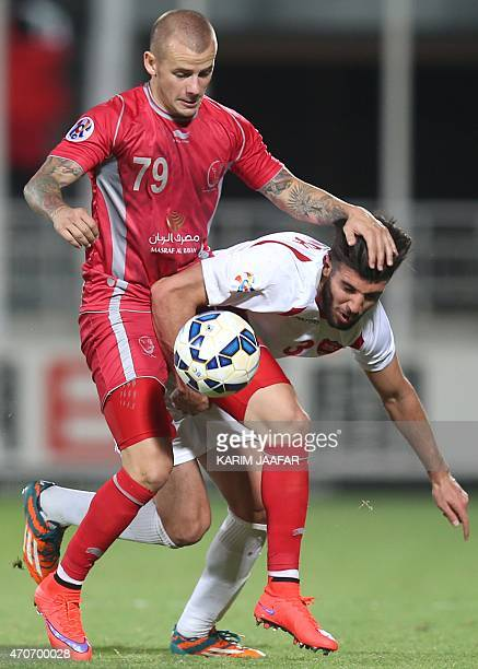 Qatar's Lekhwiya player Vladimir Weiss fights for the ball with Mohammad Khanzadeh of Iran's Persepolis during their AFC Champions League football...