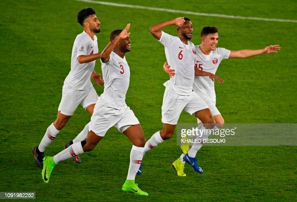 Qatar's midfielder Abdelaziz Hatim celebrates with teammates during the 2019 AFC Asian Cup final football match between Japan and Qatar at the Zayed...