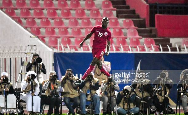 Qatar's midfielder Almoez Ali leaps into the air as he celebrates scoring a goal against Iraq during their 2017 Gulf Cup of Nations group match at Al...