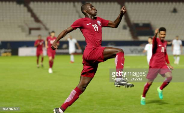 Qatar's midfielder Almoez Ali runs as he celebrates scoring a goal against Iraq during their 2017 Gulf Cup of Nations group match at Al Kuwait Sports...