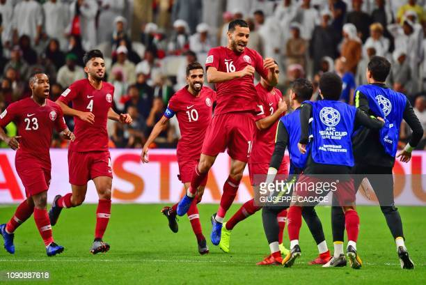 Qatar's midfielder Boualem Khoukhi celebrates his opening goal during the 2019 AFC Asian Cup semifinal football match between Qatar and UAE at the...