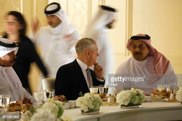 Qatar's Minister of Defense Khalid bin Mohammad AlAttiyah welcomes US Defence Secretary James Mattis with a dinner at the minister's residence on...