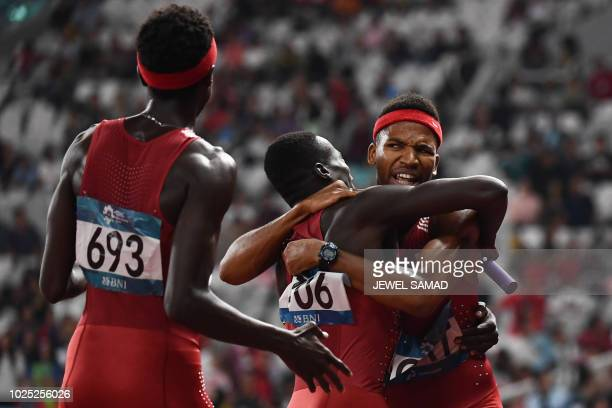 Qatar's Mohammed Abbas Abdalelah Hassan and Abderrahman Samba celebrate winning the final of the men's 4x400m relay athletics event during the 2018...