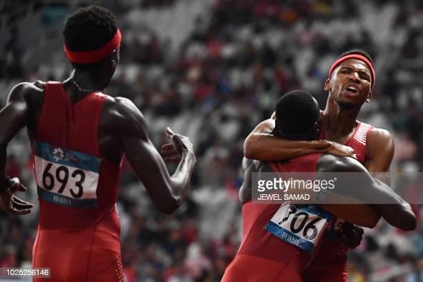 Qatar's Mohammed Abbas Abdalelah Hassan and Abderrahman Samba celebrate winning the final of the men's 4x400m relay athletics event during the 2018...