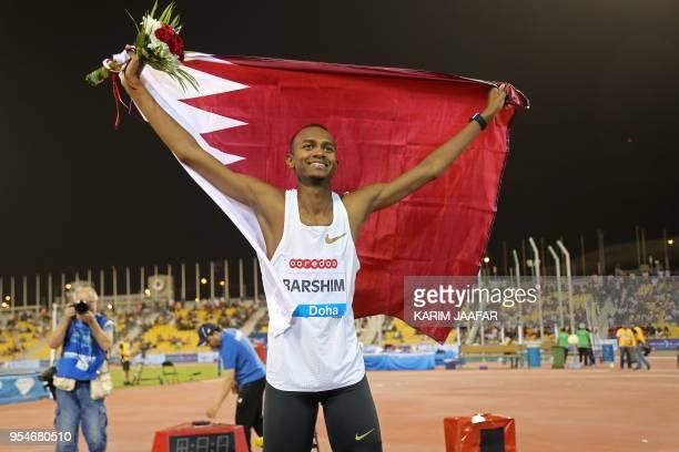 Qatar's Mutaz Essa Barshim celebrates after winning in the men's high jump during the Diamond League athletics competition at the Suhaim bin Hamad...