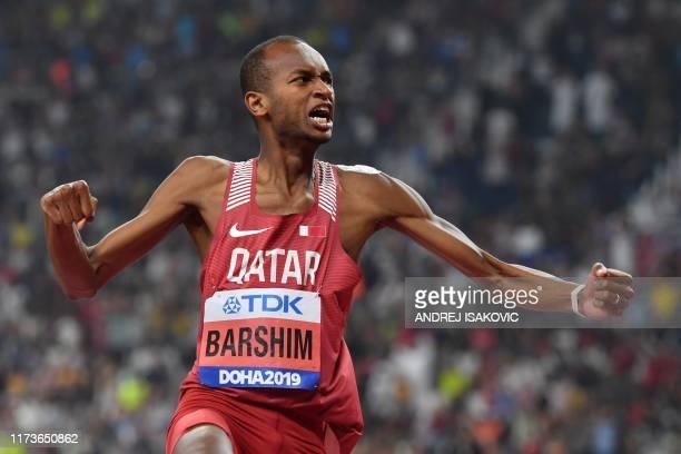 Qatar's Mutaz Essa Barshim celebrates as he competes in the Men's High Jump final at the 2019 IAAF Athletics World Championships at the Khalifa...