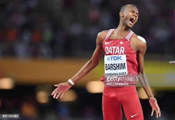 TOPSHOT Qatar's Mutaz Essa Barshim celebrates winning gold in the final of the men's high jump athletics event at the 2017 IAAF World Championships...