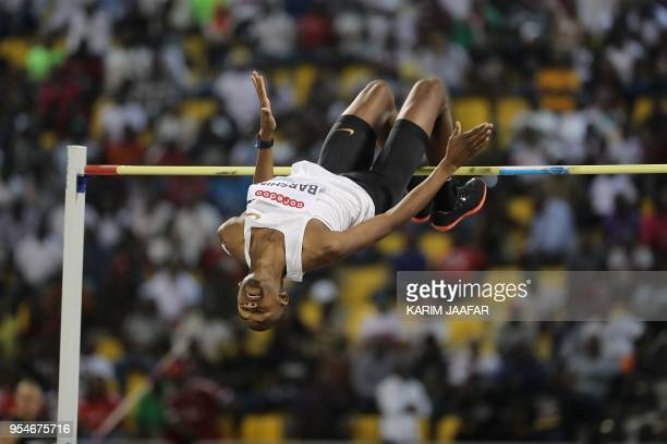 Qatar's Mutaz Essa Barshim competes in the men's high jump during the Diamond League athletics competition at the Suhaim bin Hamad Stadium in Doha on...