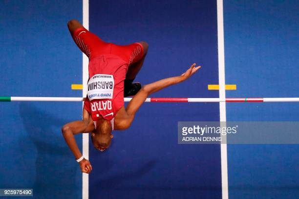 Qatar's Mutaz Essa Barshim competes in the men's high jump final at the 2018 IAAF World Indoor Athletics Championships at the Arena in Birmingham on...