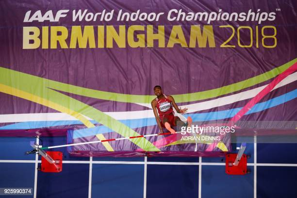 Qatar's Mutaz Essa Barshim fails a jump as he competes in the men's high jump final at the 2018 IAAF World Indoor Athletics Championships at the...