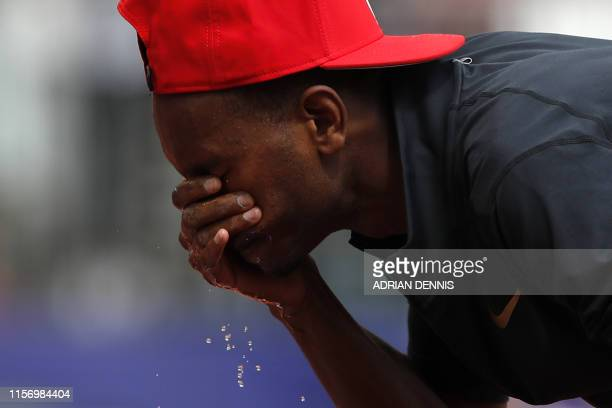 Qatar's Mutaz Essa Barshim splashes his face in the Men's High Jump event during the the IAAF Diamond League Anniversary Games athletics meeting at...