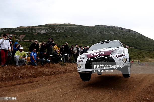 Qatar's Nasser Alattiyah and his Italian codriver Giovanni Bernacchini drive their Citroen DS3 WRC at Thiva special stage during the Acropolis rally...