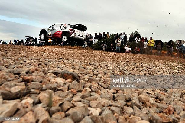 Qatar's Nasser Alattiyah and his Italian codriver Giovanni Bernacchini drive their Citroen DS3 WRC during the Thiva special stage of the WRC...