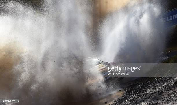 Qatar's Nasser al-Attiyah powers through a water crossing in his Ford on the final day of the Rally of Australia, near Lowanna on the New South Wales...