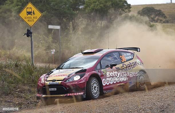 Qatar's Nasser alAttiyah slides his Ford through a corner during the second of the World Rally Championship Rally of Australia near Macksville on the...