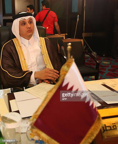 Qatar's permanenet representative at the Arab League Osama Yussef Qaradawi attends an economy finance and trade affairs meeting in Baghdad on March...