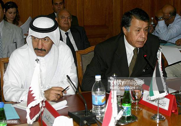 Qatar's permanent representative at the Arab League Mohammed Ali alMalki and his Palestinian counterpart Mohammed Sobeih attend an emergency meeting...