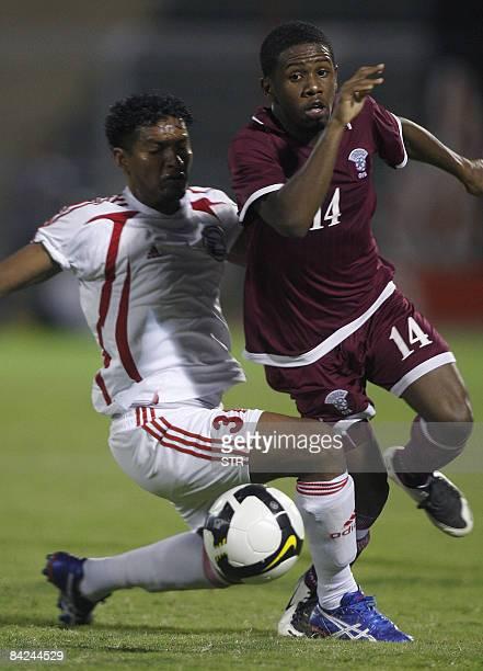 Qatar's player Khalfan Ibrahim vies with Thamer Hanash of Yemen during their 19th Gulf Cup football match in Muscat on January 11 2009 Qatar won 21...
