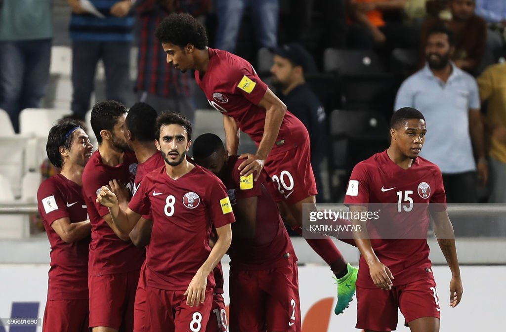 Qatar's players celebrate after scoring a goal during the World Cup 2018 Asia qualifying football match between Qatar and South Korea at the Jassim Bin Hamad stadium in Doha on June 13, 2017. /