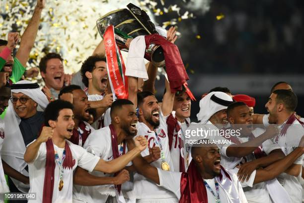 TOPSHOT Qatar's players celebrate with the trophy after winning the 2019 AFC Asian Cup final football match between Japan and Qatar at the Zayed...