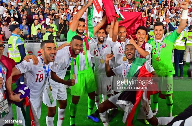 Qatar's players celebrate with the trophy after winning the 2019 AFC Asian Cup final football match between Japan and Qatar at the Zayed Sports City...