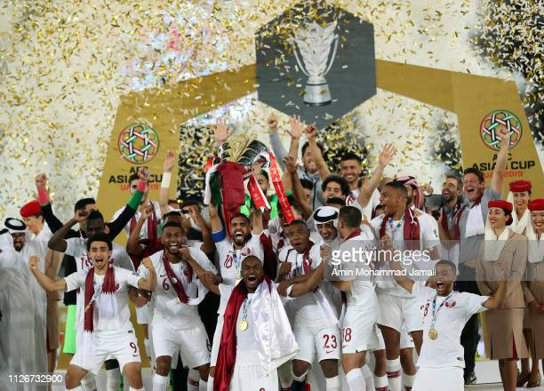 Qatar's players celebrate with the trophy after winning the AFC Asian Cup final match between Japan and Qatar at Zayed Sports City Stadium on...