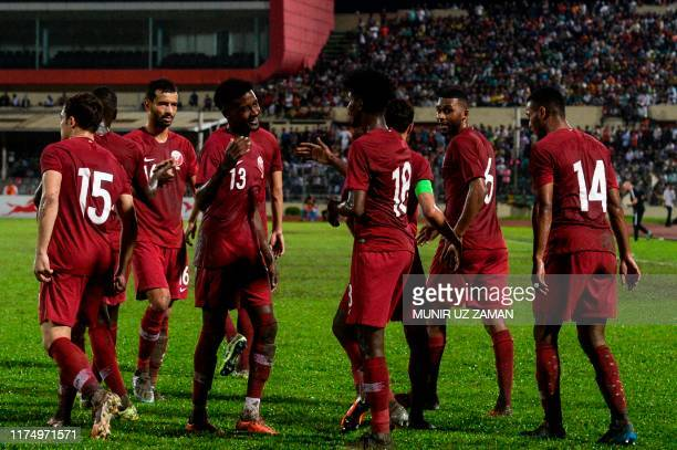 Qatar's players celebrates after scoring a goal during Asia Group EFIFA World Cup 2022 andthe 2023 AFC Asian Cupqualifying football match between...