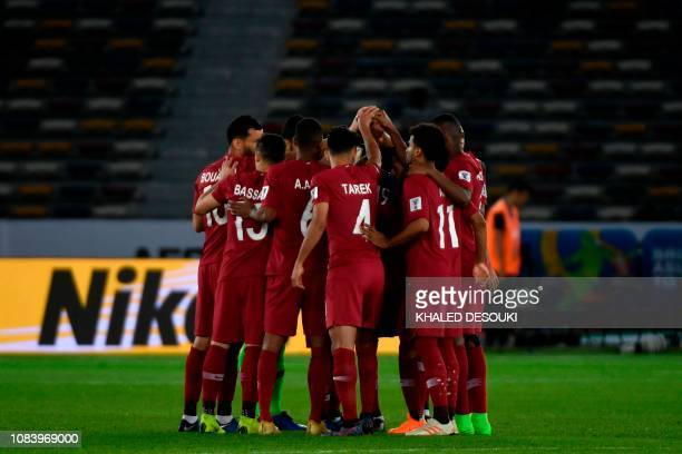 Qatar's players gather in a huddle during the 2019 AFC Asian Cup group E football match between Saudi Arabia and Qatar at the Zayed Sports City...