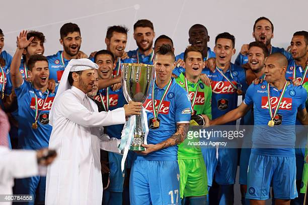 Qatar's Prime Minister Sheikh Abdullah bin Nasser bin Khalifa alThani presents Napoli's Slovak midfielder and captain Marek Hamsik with Italian Super...