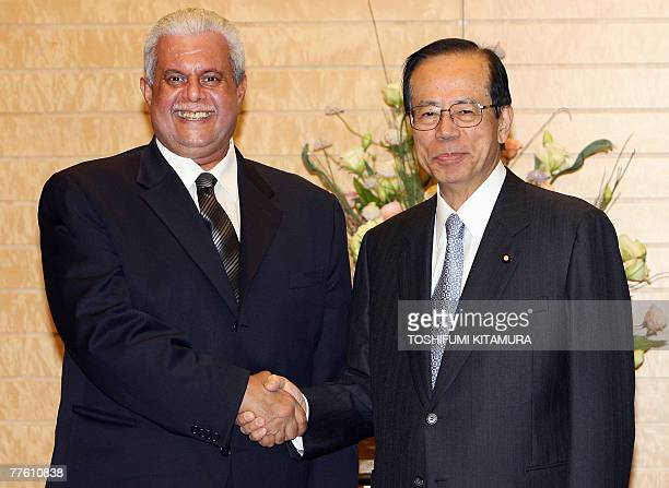 Qatar's second deputy Prime Minister and Minister of Energy and Industry Abdullah bin Hamad Al Attiyah is welcomed by Japanese Prime Minister Yasuo...